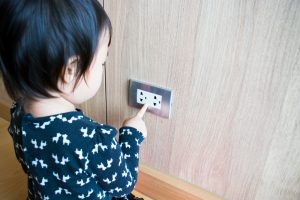 A,Child,Is,Trying,To,Poke,Into,Electrical,Outlets.,Kid